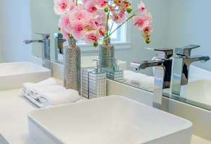 a clean and tidy bathroom sink with flowers