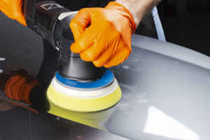 buffing out wax on a silver car