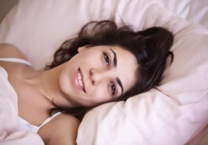 woman happy in bed with an electric blanket